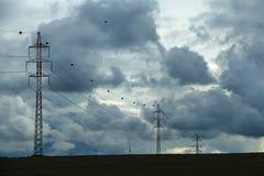 Linhas elétricas no campo Foto de Stock Royalty Free