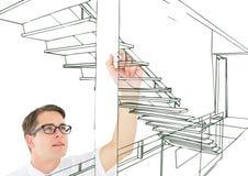 linhas verdes das escadas do escritório de desenho do homem novo na tela Imagem de Stock Royalty Free