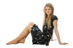 linia atrakcyjna dziewczyna siedzi slim Fotografia Stock