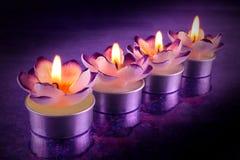 Linie von geformten Kerzen der Blume Stockfotos
