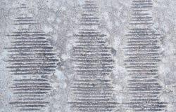Linien des konkreten Hintergrundes auf dem Boden Stockfoto