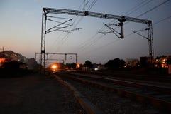 Linii kolejowej stacja przy nocą Fotografia Stock
