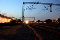 Linii kolejowej stacja przy nocą Obrazy Stock