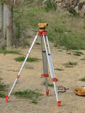 Lining Up. Theodolite measuring levels on site for house Stock Photo