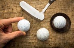 Lining up golf balls Stock Photos