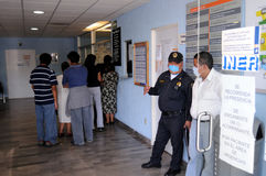 Lining up for influenza checkup in Mexico stock images