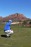 Lining up a Putt in Sedona. A golfer lining up a putt in scenic sedona arizona Royalty Free Stock Images