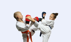 With linings on hands boy and girl are beating kicks Royalty Free Stock Photos
