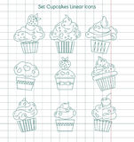 Linjära muffinsymboler på anteckningsbokarket Arkivfoton