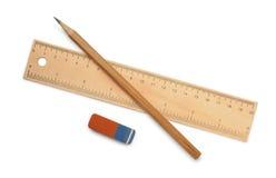 Linjal, blyertspenna och radergummi royaltyfri bild