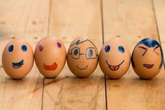 Linje av ägg med den olika ansiktsbehandlingen Royaltyfria Bilder