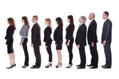 Linje av affärsfolk i profil Royaltyfri Bild