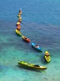 Linje av färgrika kajaker Royaltyfri Fotografi
