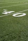 Linje för gård 40 på fält för amerikansk fotboll Arkivfoto