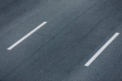 Linje markering på vägtexturbakgrund Royaltyfri Fotografi
