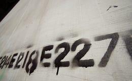 linje nummerstencil för 02 grafitti Arkivbilder