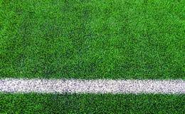 Linje sidor av konstgjord gräsfotboll & x28; soccer& x29; fält arkivfoto