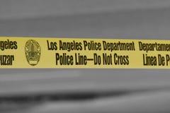 Linjen för den Los Angeles polisenpolisen - korsa inte bandet Arkivfoton