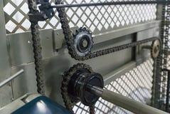 Linjen industriell transportör för axel för chain drev Royaltyfri Foto