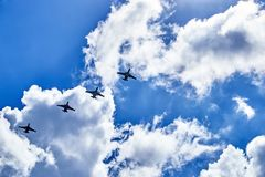 The link of combat bombers. Su-24 in the blue sky between the clouds Royalty Free Stock Image