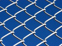 Link Fence. Chain link fence with a blue sky Royalty Free Stock Photography