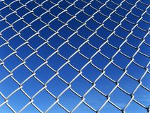 Link Fence. Chain link fence with a blue sky Stock Images