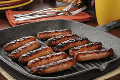 Link sausage. Grilled link sausage in a cast iron pan Stock Photos