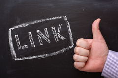 Link Thumbs Up. The word Link in stencil letters on a blackboard with a hand giving the thumbs up sign Stock Photos