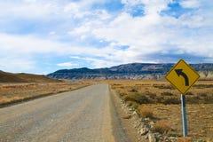 Linke Kurve roadsign stockbild