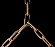 Linked chains as coalition metaphor. Aged iron chain isolated on black Royalty Free Stock Photos