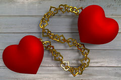 Linked hearts. Two rendered red hearts connected by golden chain Royalty Free Stock Photo