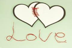 Linked hearts Stock Photo