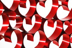 Linked red ribbon hearts. Isolated on white background stock images