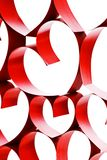 Linked ribbon hearts. Linked red ribbon hearts isolated on white background royalty free stock photography