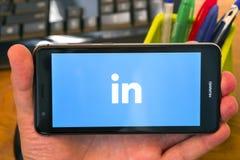Linkedin logo on the phone royalty free stock photos