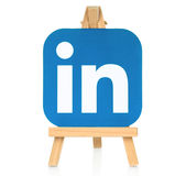 LinkedIn logo placed on wooden easel. Kiev, Ukraine - August 30, 2016: LinkedIn logo printed on paper and placed on wooden easel. LinkedIn is a well-known social stock images
