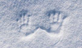 Linker en juiste menselijke af:drukken in de sneeuw Royalty-vrije Stock Afbeeldingen