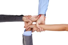 Linking arms. Businesspeople linking arms, demonstrating business unity Stock Photo