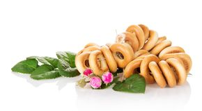 Linking bagels and buds of rose Stock Photos