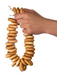 Linking of bagels in the female hand Stock Images