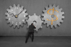 Linking concrete gears for time is money concept Royalty Free Stock Images