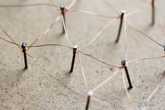 Linking entities network connected. Linking entities. Network, networking, social media, connectivity, internet communication abstract. Web of threads on cork Stock Photos