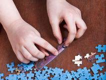 Linking of jigsaw puzzles Royalty Free Stock Photography