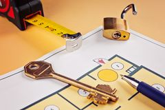Linking new key on project plan of apartment house Stock Photography