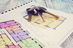 Linking new key on project plan of apartment house Stock Photos