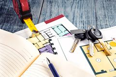 Linking new key on project plan of apartment house Stock Photo