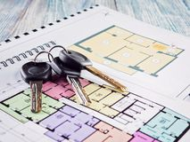Linking new key on project plan of apartment house Royalty Free Stock Photos