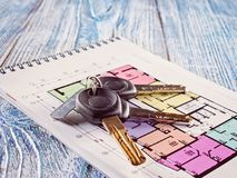 Linking new key on project plan of apartment house Royalty Free Stock Image