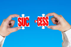 Linking two puzzles for success Royalty Free Stock Photography