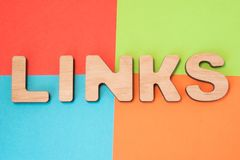 Links in search engine optimization SEO concept photo. 3D letters form word Links means backlinks and hyperlink in web, part of In. Ternet marketing in 4 colors royalty free stock photos